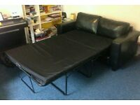 Black Leather Sofa Bed. Was £650 now only £240. *Free Delivery*