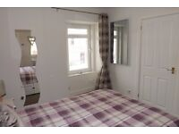 Lovely quiet 2 bedroom First Floor Flat for Sale in Alness. Own off street parking.