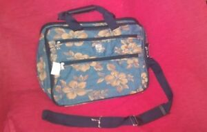 Blue brief case style bag with gold flower pattern