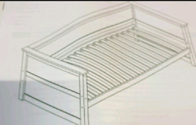 A new still boxed stylish white wooden day day bed frame .