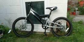 Boys or girls bike muddy fox ready to ride.