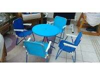 Round garden table and 4 folding chairs
