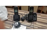 Digital cordless telephone with answer machine.