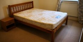 Double wood bed frame and double firm mattress (slight night)
