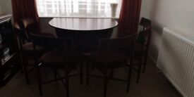 Mahogany Stained Drop Leaf Table and 6 Chairs
