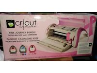 Pink Cricut Expression digital cutting machine with 3 carts & 2 mats.