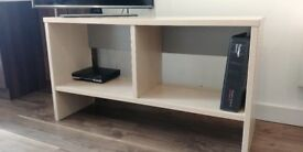TV stand, with book storage. Cream. Good condition.
