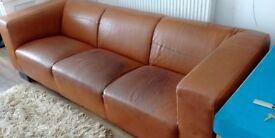 Modern tan leather sofa