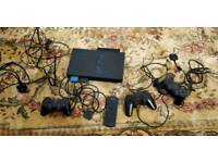 PS2 console with lots of EXTRAS