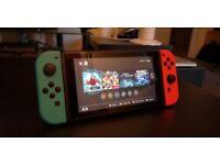 Nintendo Switch neon - with games (Mario Kart, Bayonetta)
