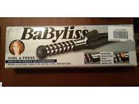 BABYLISS CURL N PRESS TONGS..