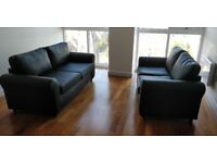 Two (two seaters) Faux Leather Black Sofas - Great Quality.