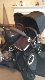 Black Bugaboo Donkey with Carrycot & 2 Seat Units