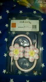 Pink flower curtain holders new unused