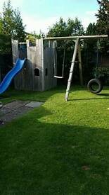 Kids play castle with slide