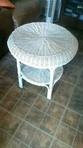 SMALL WHITE ROUND WICKER TABLE.