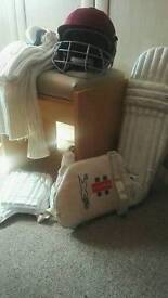 Full cricket gear including slazenger pads, a helmet, whites and accessories