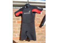 Kids' wetsuit of size L for sale including 2 (boy & girl) shorties and 2 long sleeved (boy&girl) .
