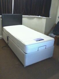 Adjustable bed with mattress and headboard