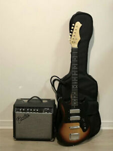 Selling electric guitar(with case) + amp(with power but no cord)