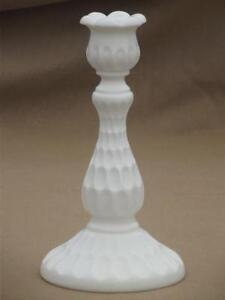 Unmarked Pair of Fenton milk glass thumbprint candle holders