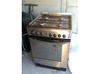 Freestanding Indesit Cucina Stainless Steel cooker with electric fan assisted oven and gas hob..