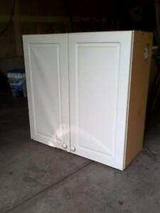 2 white kitchen cabinets with doors. $70. each tx 289 893 1362