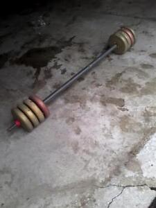 """1"""" steel bar with weights. i used this for doing squats.$55."""