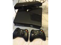 Xbox 360 Kinect plus 2 controllers and 12 games £75