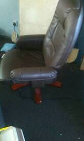 Brown leather reclining chair an matching foot stool