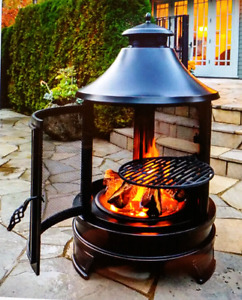 Outdoor wood burning round cooking fire pit