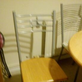 Kitchen table and four chairs.