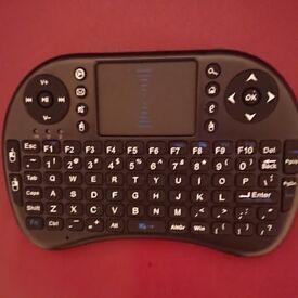Mini Wireless Handheld Keyboard, TouchPad combo