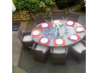 Glass topped outside table and eight matching chairs complete with sun umbrella