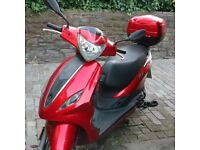 Red Piaggio Fly 4T with store box