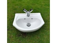 Small wash hand basin with tap.