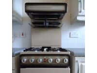 Old style gas cooker with grill at the top.