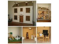 1/12th scale Dolls House. 3 floors with wiring and many many extras, unfinished project.