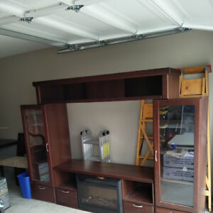 Beautiful Entertainment Center with electric fireplace.