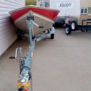 Lund boat with 9.9 Mercury and EZ loader trailer