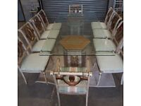Huge glass dinning table and 10 chairs Ideal party table.