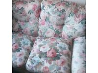 TWO SEATER SPRUNG SOFA BED IN CHINTZ