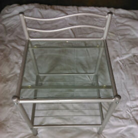 2 Glass topped bedside tables