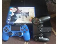 PlayStation 4 with games and controllers