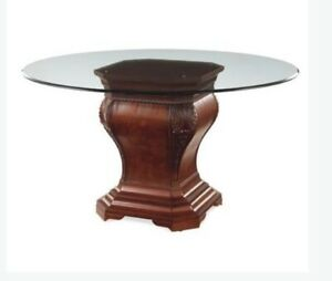 Glass top dining table with wooden base