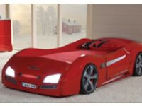 Kids Car bed. Red, with lights and sound. In fantastic condition comes with mattress.