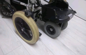 Electric wheelchair assistant control