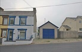 SNOWDONIA (NORTH WALES): End terrace house with planning consent for 2/3 bed detached house