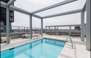 **** 4 1/2 CONDO - CENTRE BELL - FULLY FURNISHED - JULY ONLY ***