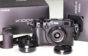 Black Fujifilm X100F with case, grip, extra battery